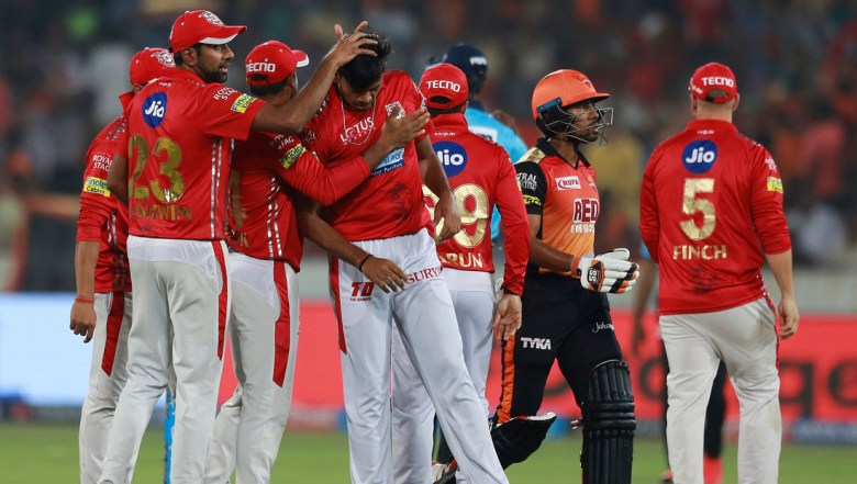 Kings XI Punjab bowler Ankit Rajpoot, center, celebrates the wicket of Sunrisers Hyderabad batsman Wriddhiman Saha