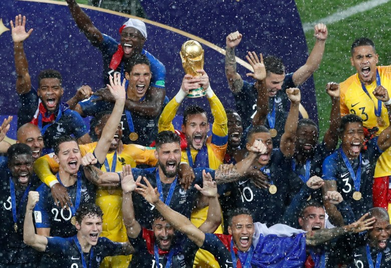 France players celebrate with the trophy after defeating Croatia in the final at the 2018 soccer World Cup in the Luzhniki Stadium in Moscow