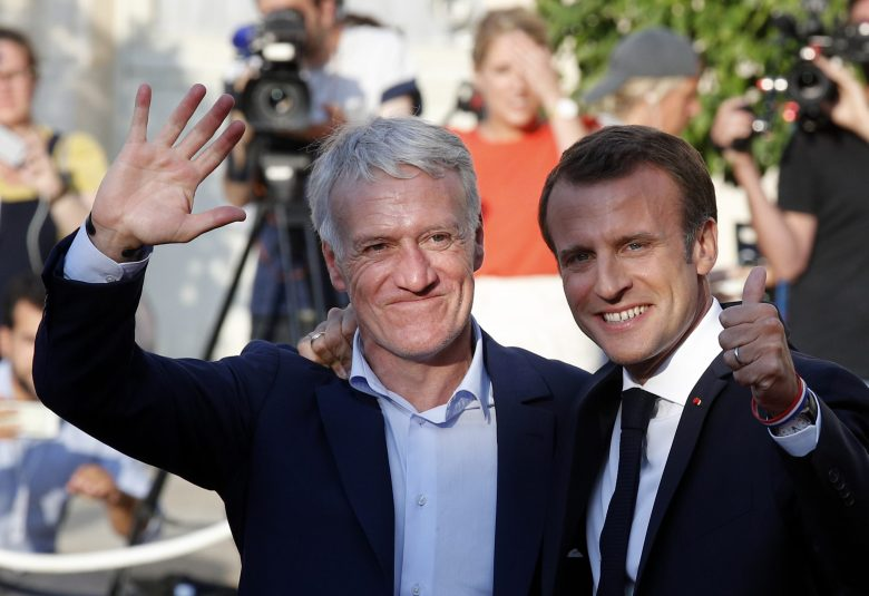 French President Emmanuel Macron, right, and French national soccer head coach Didier Deschamps, wave at the Elysee Palace