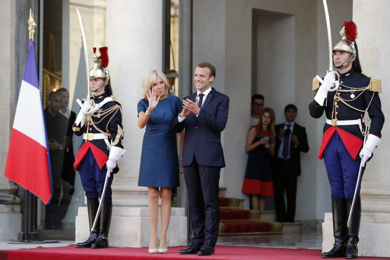 French President Emmanuel Macron and his wife Brigitte, wait for the arrival of French soccer team at the presidential Elysee Palace