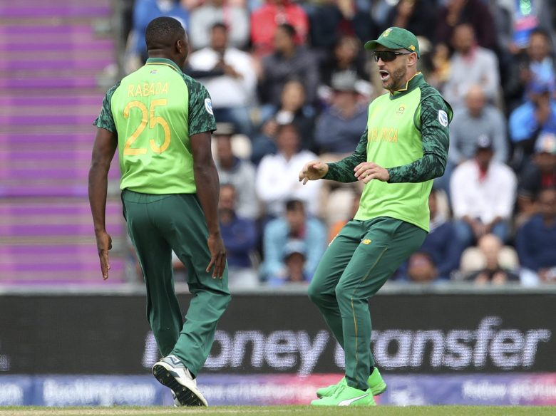 South Africa's Kagiso Rabada, left, celebrates with captain Faf du Plessis, right, the dismissal of India's Shikhar Dhawan