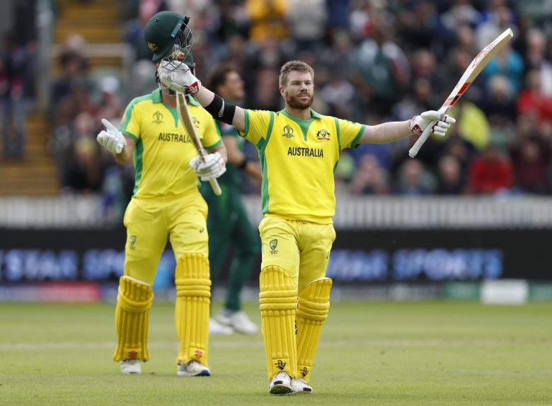 Australia's David Warner, right, celebrates after getting 100 runs not out