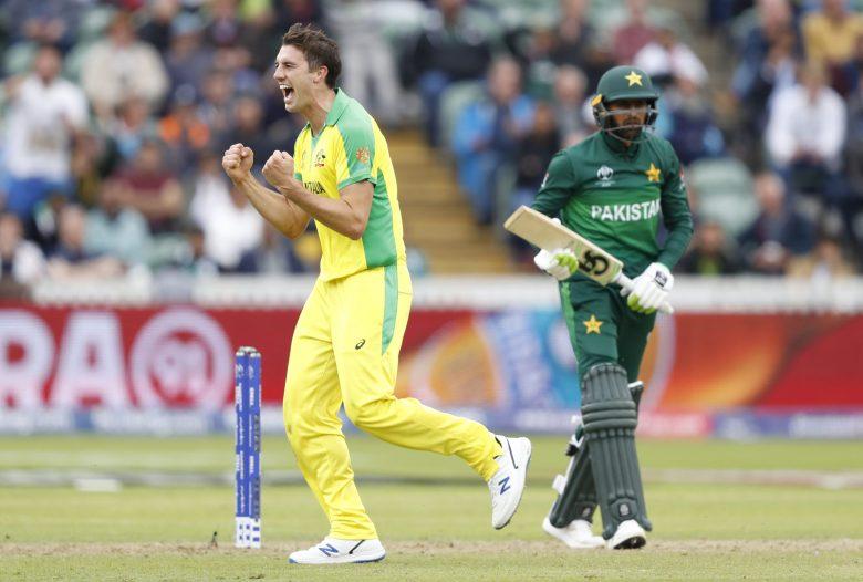 Australia's Pat Cummins celebrates after taking the wicket of Pakistan's Asif Ali caught behind by Australia's Alex Carey