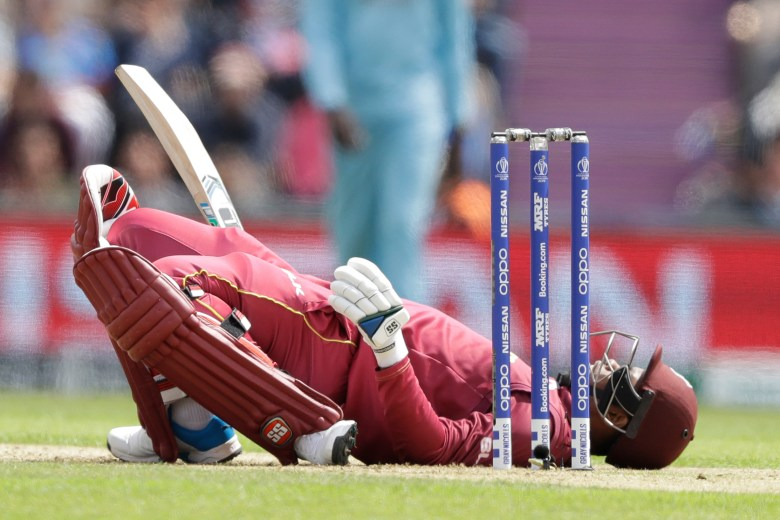 West Indies' Shimron Hetmyer lies back on the pitch after ducking a bouncer