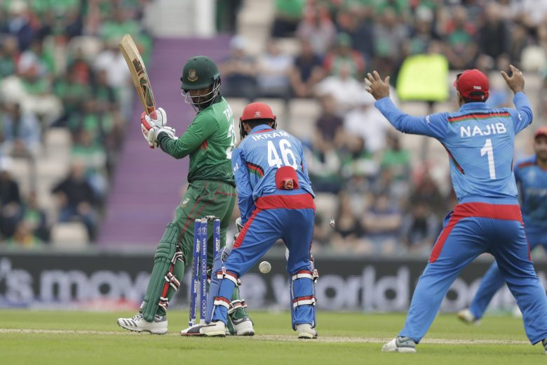 Bangladesh's Tamim Iqbal, left, is bowled out by Afghanistan's Mohammad Nabi, not pictured