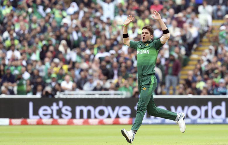 Pakistan's bowler Shaheen Afridi reacts after his delivery against New Zealand's batsman James Neesham