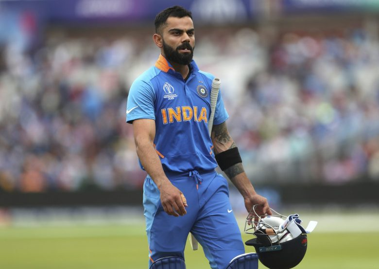 India's captain Virat Kohli leaves the field after being dismissed by New Zealand's Trent Boult