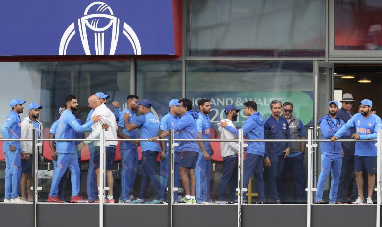Indian cricketers greet each other after their team lost the Cricket World Cup semifinal match