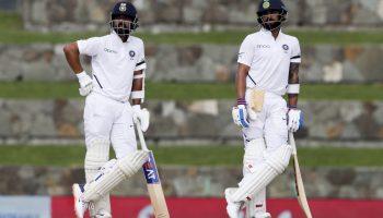 India's captain Virat Kohli, right, and teammate India's Ajinkya Rahane wait for a decision