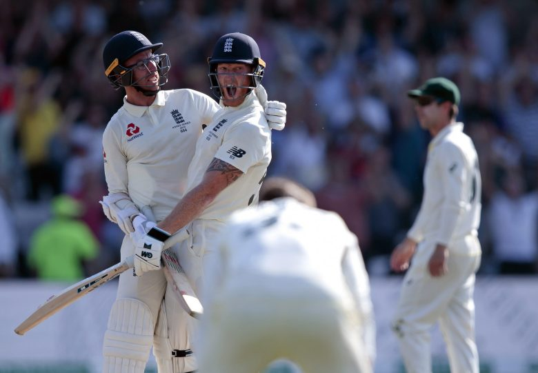 England's Ben Stokes, center, with Jack Leach celebrates after scoring the winning runs on the fourth day of the 3rd Ashes Test cricket match