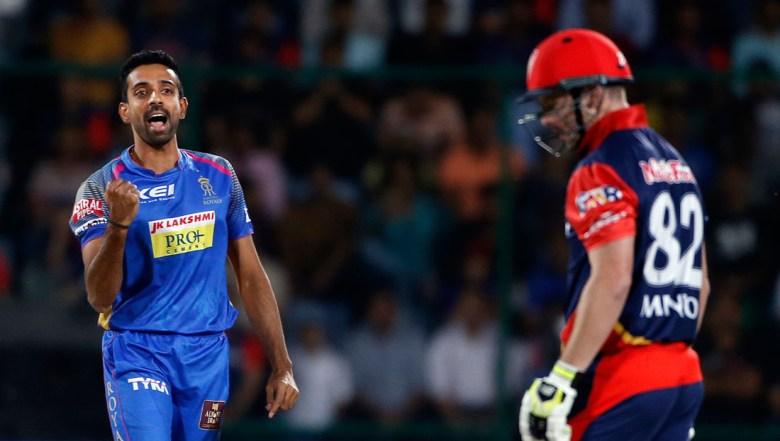 Rajasthan Royals' Dhawal Kulkarni, left, celebrates the wicket of Delhi Daredevils' Colin Munro