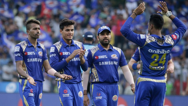 Mumbai Indian's Hardik Pandya celebrates the dismissal of Kolkata Knight Riders' Shubman Gill with his team player