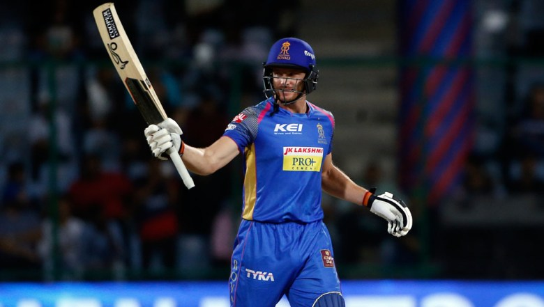 Rajasthan Royals' Jos Buttler raises his bat after scoring a quick fifty