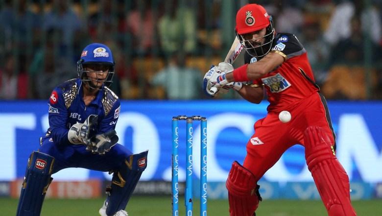 Royal Challengers Bangalore batsman Manan Vohra, right, bats during the VIVO IPL Twenty20 cricket match against Mumbai Indians