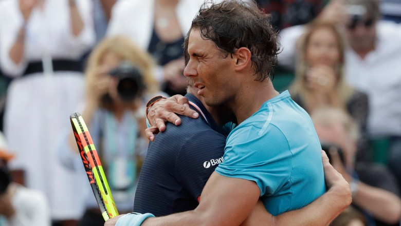 Austria's Dominic Thiem hugs Spain's Rafael Nadal who celebrates winning the men's final match of the French Open tennis tournament in three sets 6-4, 6-3, 6-2, at the Roland Garros stadium in Paris
