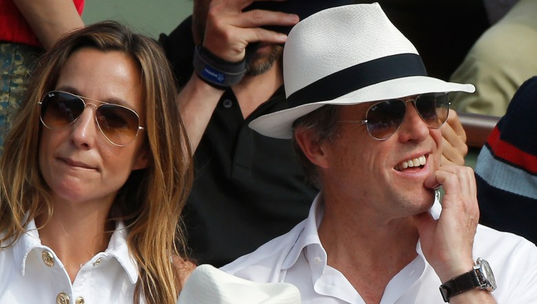 British actor Hugh Grant and his wife Anna Elisabet Eberstein watch the men's final match of the French Open tennis tournament at the Roland Garros stadium in Paris