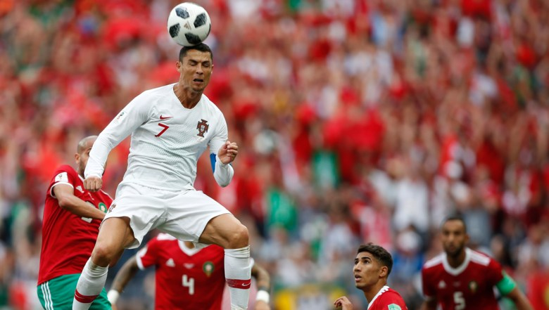 Portugal's Cristiano Ronaldo leaps up for a header during the group B match between Portugal and Morocco at the 2018 soccer World Cup in the Luzhniki Stadium in Moscow