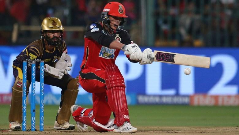 Royal Challengers Bangalore batsman Quinton de Kock, right, plays a shot