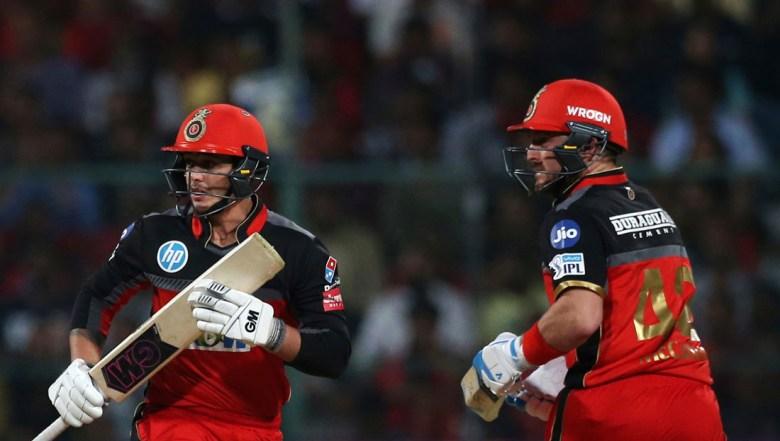 Royal Challengers Bangalore batsmen Quinton de Kock, left, and Brendon McCullum run between the wickets
