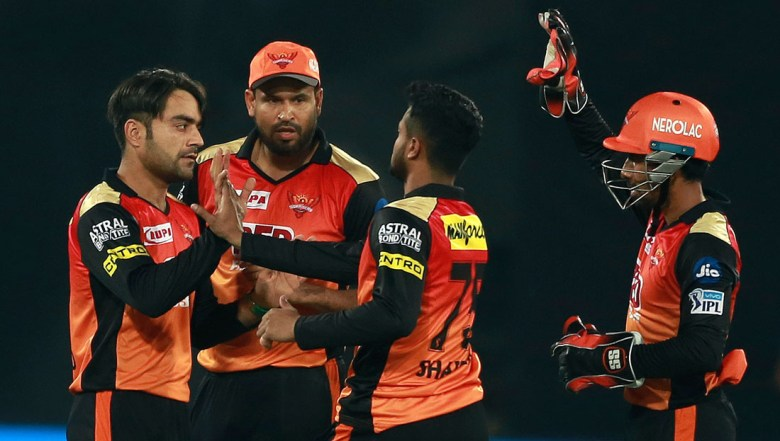 Sunrisers Hyderabad bowler Rashid Khan,left, celebrates the wicket of K L Rahul with their team members
