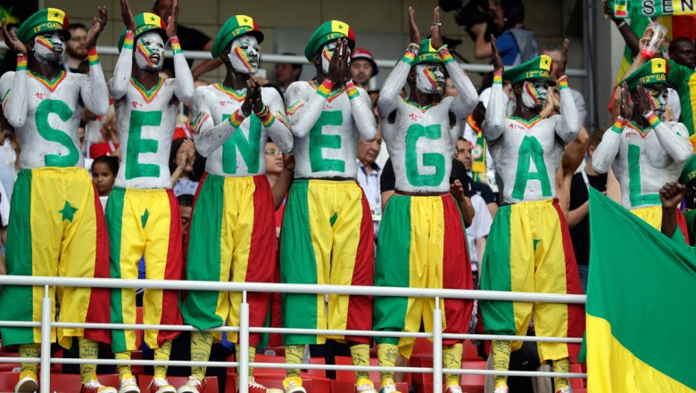 Senegal's fans, their bodies and faces painted in the colors of the national flag, support their team during the group H match between Poland and Senegal at the 2018 soccer World Cup in the Spartak Stadium in Moscow