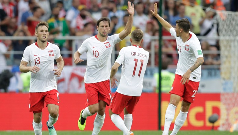 Poland's Maciej Rybus, left, Kamil Grosicki and Dawid Kownacki celebrates as Poland's Grzegorz Krychowiak, second from left, scored his team first goal during the group H match between Poland and Senegal at the 2018 soccer World Cup