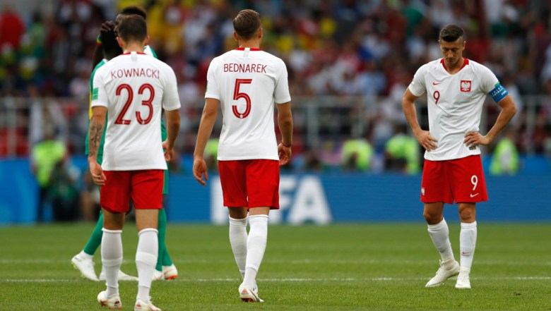 Poland players walk in dejection end of the group H match between Poland and Senegal at the 2018 soccer World Cup in the Spartak Stadium in Moscow