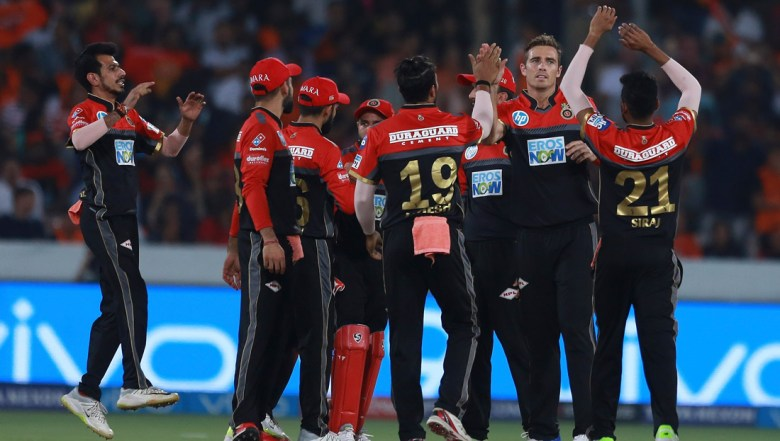 Royal Challengers Bangalore bowler Tim Southee, 2nd form right, celebrates the wicket of Alex Hales with his team