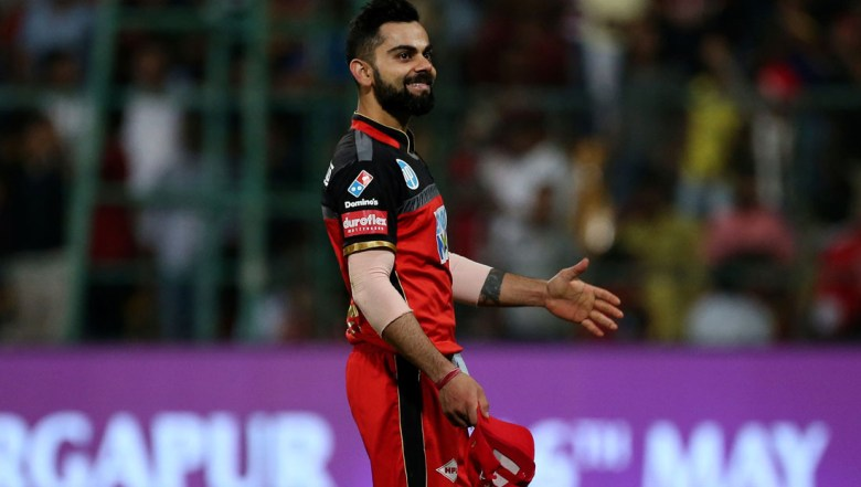 Royal Challengers Bangalore captain Virat Kohli smiles as he leaves the ground after their win over Mumbai Indians