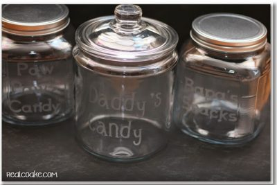 Create a stencil with your Cricut to make these candy and snack jars.