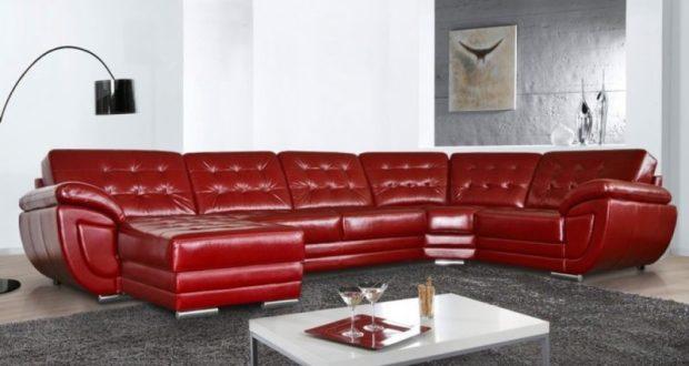 Угловой диван из кожи в интерьере гостиной
