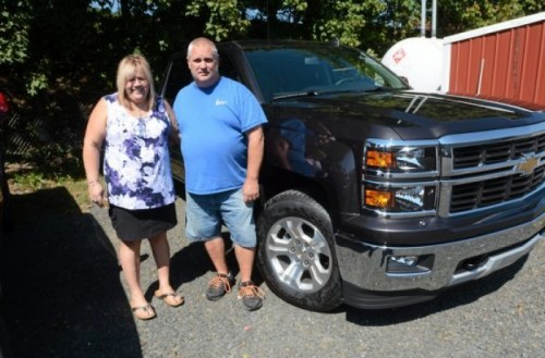 Lechleitner with accomplice  and fiancé Kerry Titus and their new car purchased with lottery winnings