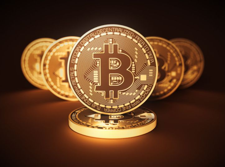 74496371 - virtual coins bitcoins on brown background