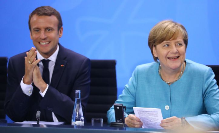 French President Macron and German Chancellor Merkel attend the press conference after the meeting at the Chancellery in Berlin