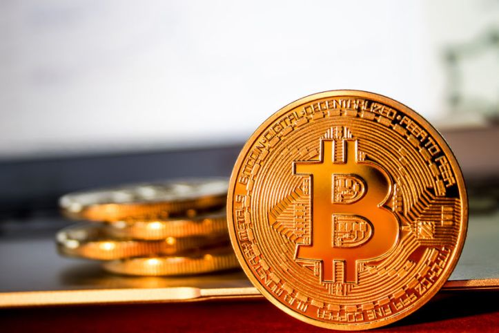 70646642 - photo golden bitcoins on laptop. trading concept of crypto currency