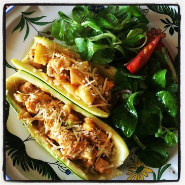 Zucchini filled with organic chicken.