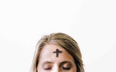 woman with ash cross on forehead
