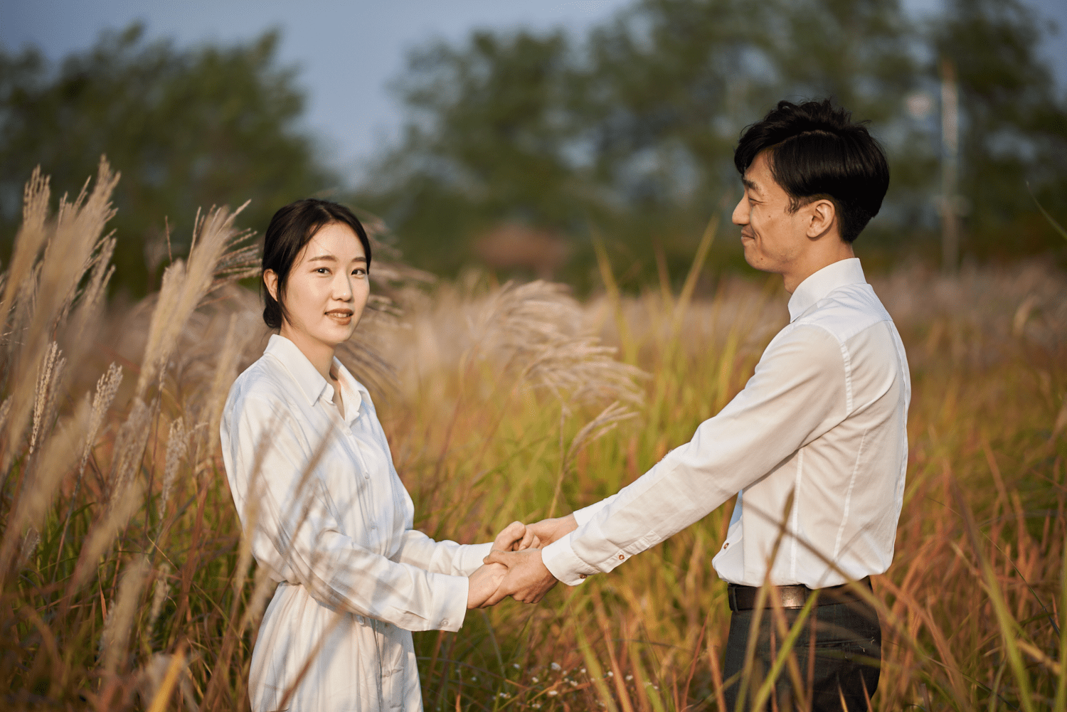 Save The Date couple portrait, holding hands