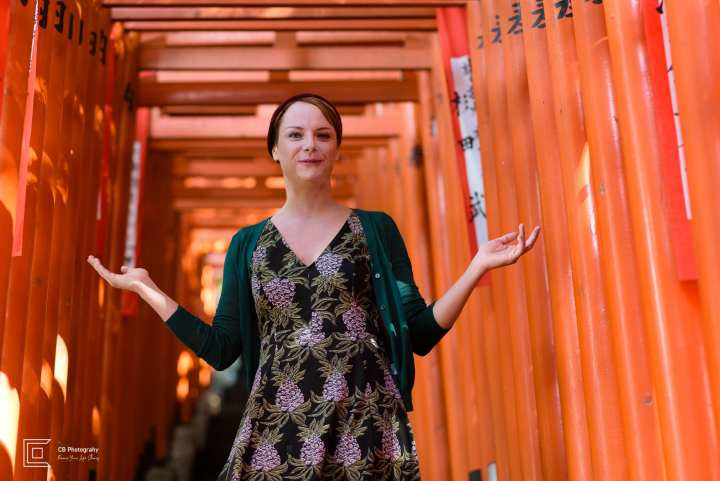 Vacation photograph for Camilla surrounded by the red torii gates at Hie Shrine in downtown Tokyo, portrait by Cristian Bucur Photographer in Tokyo Metropolitan Area