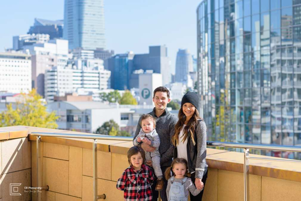 Family portrait in Roppongi Hills against the Tokyo's skyline by the family photographer Cristian Bucur