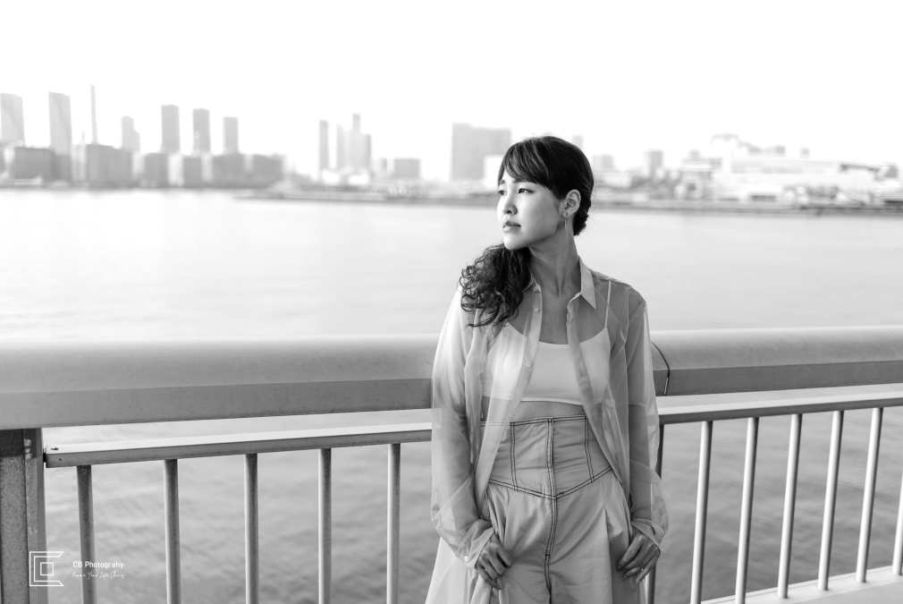 Portrait shoot in Odaiba, image from Rainbow Bridge against Tokyo's skyline