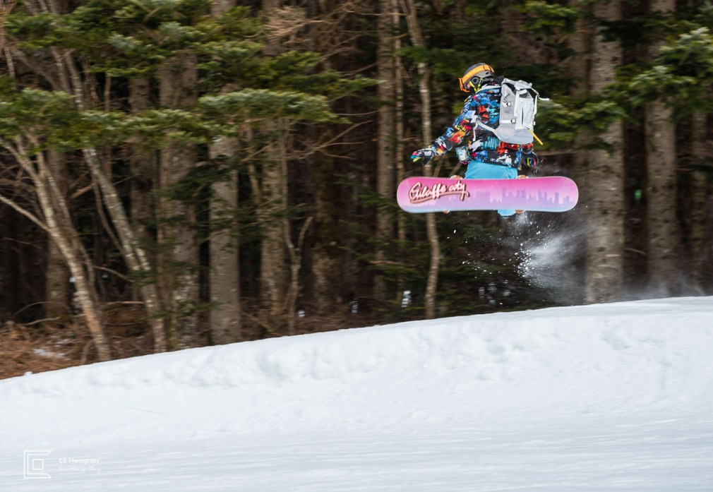 Snowboarder jumping on the slopes of Fujiten Snow Resort
