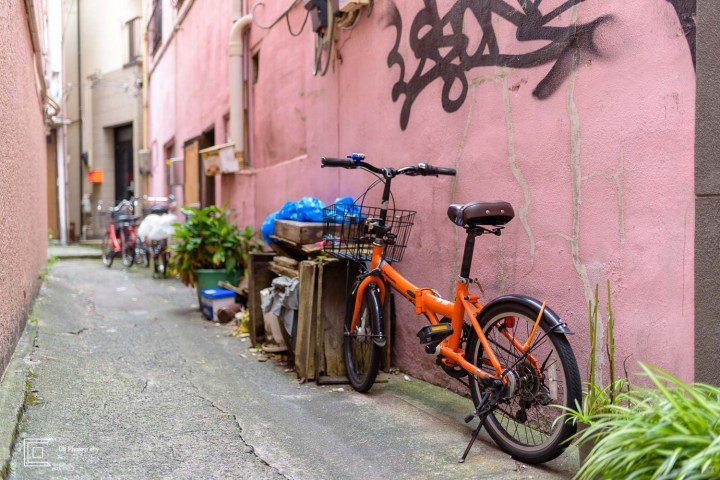 Bicycle parked in a narrow alley in Yokohama