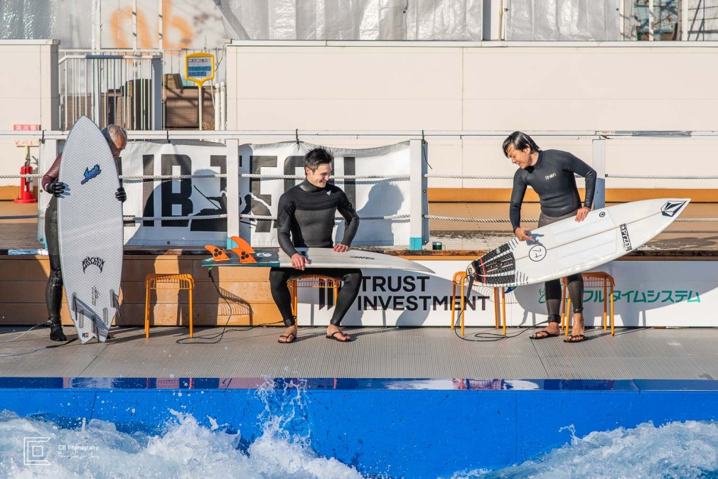 Surfers chatting while waiting turns at the Citywave Tokyo
