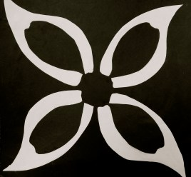 White and black paper design made from a single leaf to create a flower.