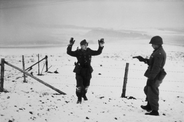 BELGIUM. W.W.II. Ardennes. Battle of the Bulge. Near Bastogne. December 23rd-26th, 1944. An American soldier capturing a German soldier.