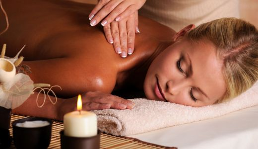 professional masseur doing  massaging  female neck  in the beauty salon