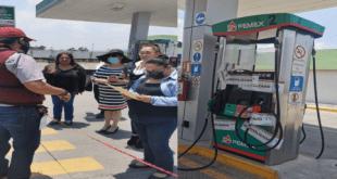 Pese a resistencia, inmovilizan dispensadores en gasolinera de Tulancingo