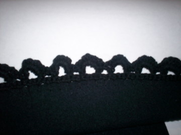 detail of crocheted embellishment to sweatshirt to create cardigan