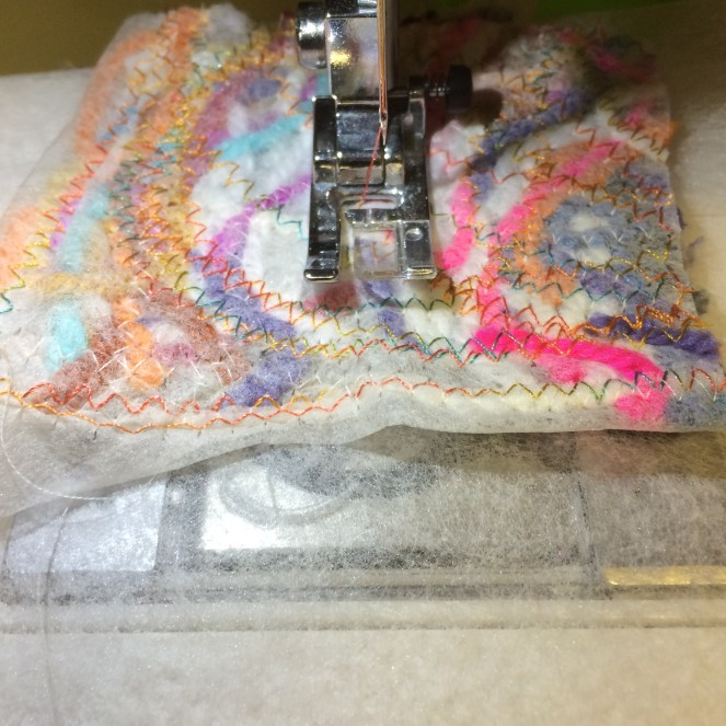 Continue to use a zigzag stitch and the same thread as before